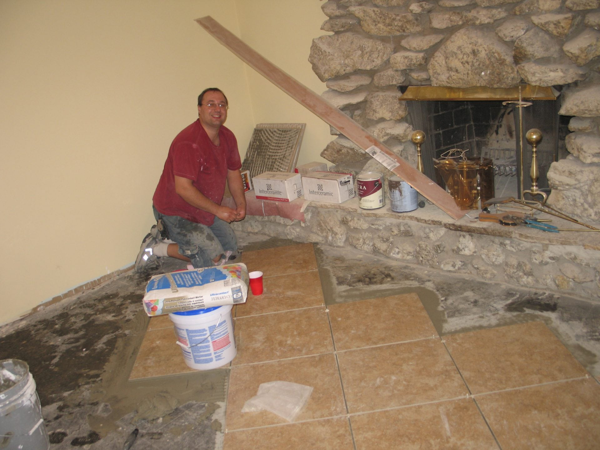 contractor near fireplace