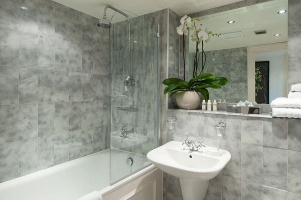 grey bathroom with flowers